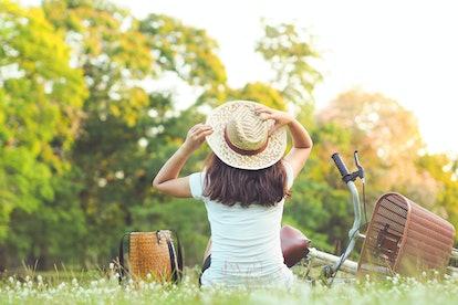 woman sitting near her bike in park