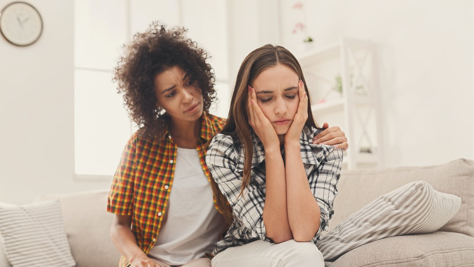 Woman consoling her depressed friend at home, closeup. Female friendship, support and care, copy space