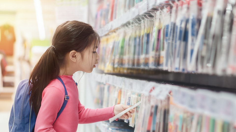 Back to school concept, Little asian girl or pupil buying school supplies in store, Selective focus