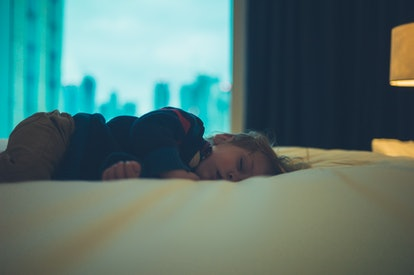 A little toddler is sleeping in a city apartment