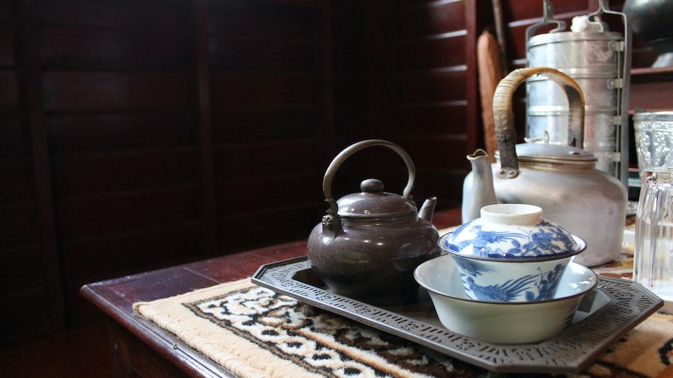 old antique vintage Thai style silverware, ceramic, brass tea pot and tea cup