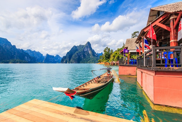 landscape and long-tailed boat  in Ratchaprapha Dam at Khao Sok National Park, Surat Thani Province, Thailand.