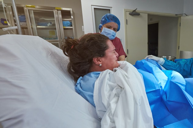 A woman in labor in a hospital