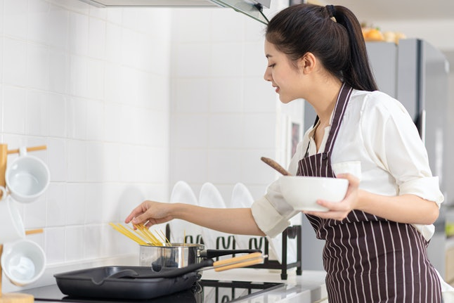 Women are cooking breakfast, Asian women are cooking breakfast in the kitchen.