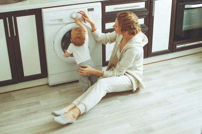Woman washes with the child