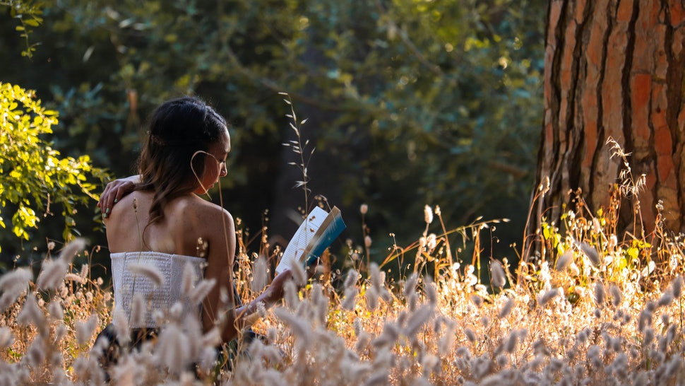 Girl Reading in the forest
