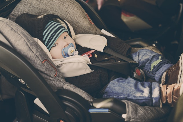 baby boy in carseat