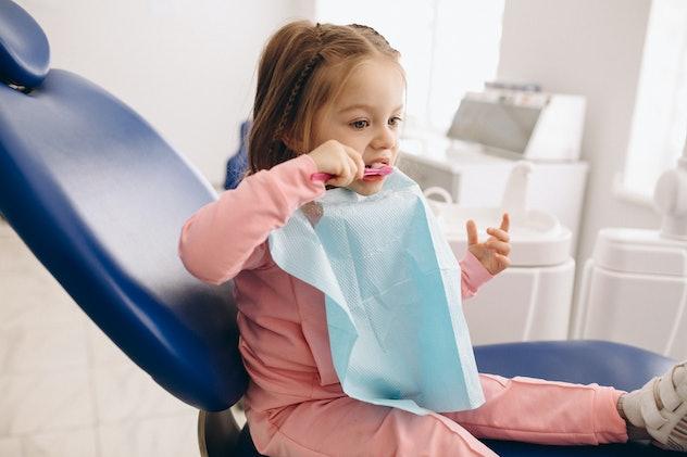 Cute girl brushing teeth dentistry
