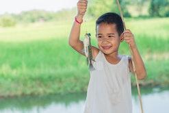 Little Boy Catching a Fish. Kids Fishing.