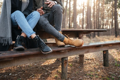 Cropped image of loving couple sitting outdoors in the forest.