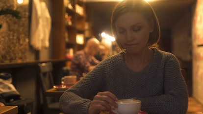 Sad woman sitting in cafe, painfully experiencing break-up, loneliness, crisis
