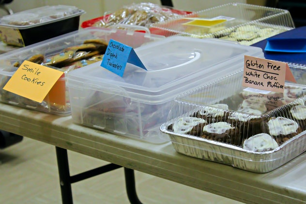 Items set up on a table at a bake sale.