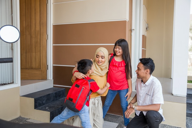 asian kid boy and girl hug their parents before going school