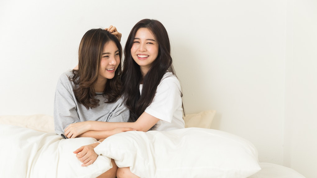 Young Asian Girls chit chat on the bed