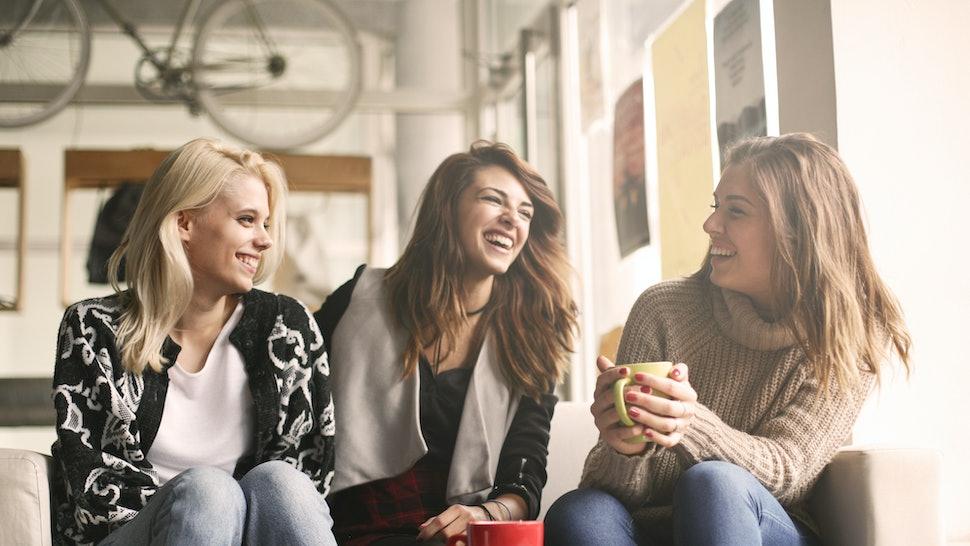 Girls having fun at home, laughing.