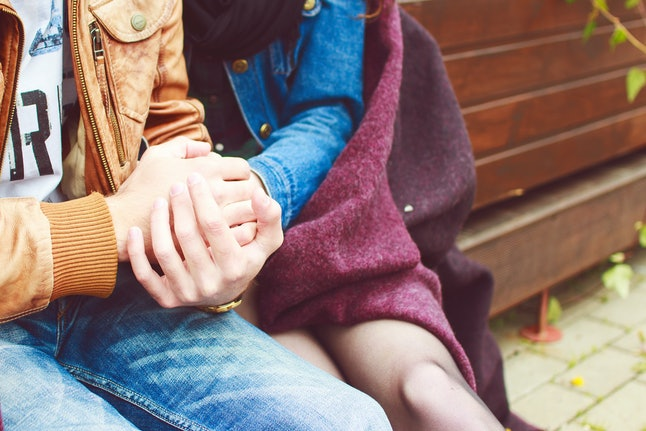 couple hugging and holding hands