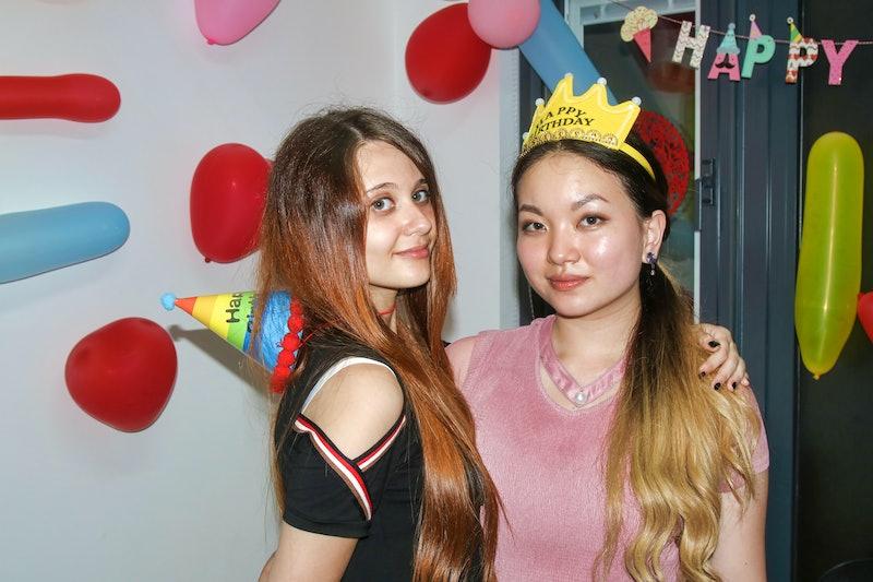 Two Beautiful Young Girls Celebrating Birthday,white girls,european girls,blonde haired girl, red haired girl, celebrating birthday,women,birthday balloons,