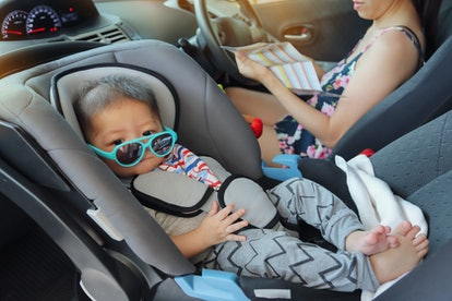 mother and son drive road trip family travel in summer vacation day, cute baby boy sitting on car seat