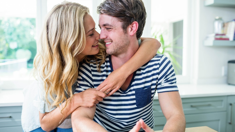 Cute couple hugging at home