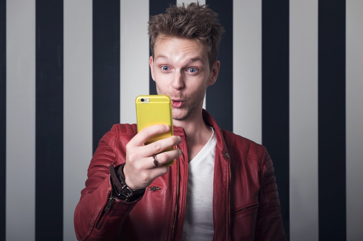 Man looking funny at his cellphone
