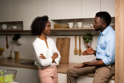 African american couple talking in kitchen