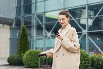 . Business woman at international airport moving to terminal gate for airplane travel trip - Mobility concept and aerospace industry flight connections