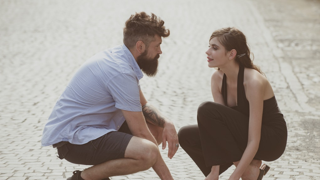 Love at first sight. Man and woman falling in love. Bearded man and cute woman met on street. Hipster helping and looking at pretty girl. Couple in love on summer day. Enjoy romantic date and dating.