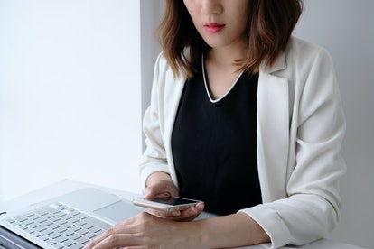 beautiful young  asian business woman  use phone and working in the office or home with calculator laptop and computer.