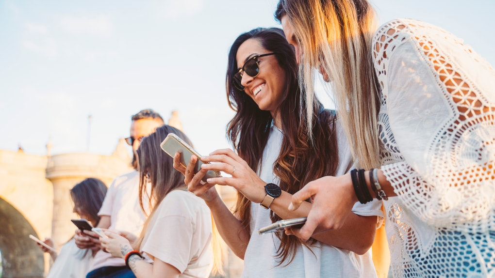 Group of friends watching media on a smartphone