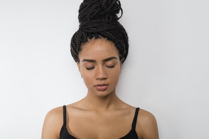 Profile view of young woman with eyes closed