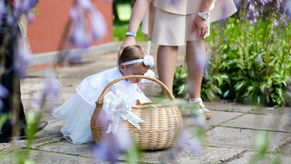 Kid with white beautiful dress on christening celebration