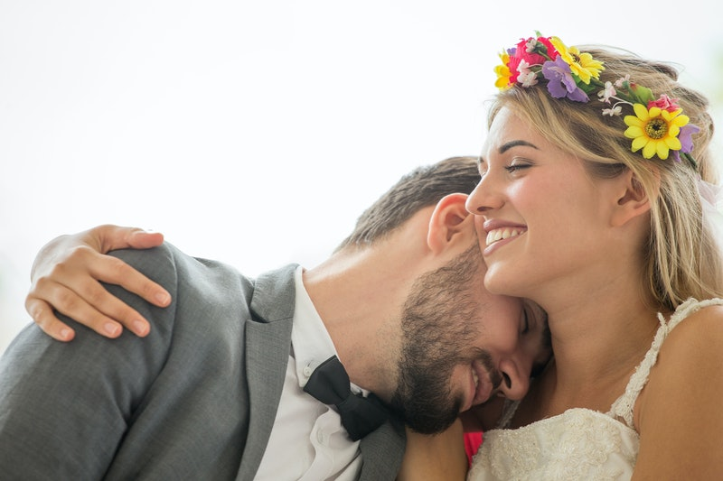 young couple in love Wedding Bride and groom embracing together on white background . Newlyweds. Closeup portrait of a beautiful having a romantic moment