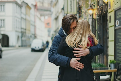 Romantic young couple in love, hugging on the street