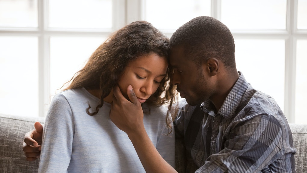 Loving African American husband touching wife face with tender, apologizing after quarrel, man comforting woman, health problem, interruption unwanted pregnancy, miscarriage, relationships trouble
