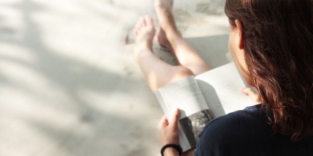 Woman reading book on the Beach