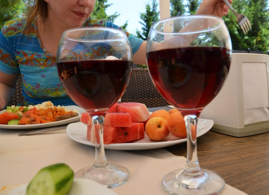 Two female friends drinking wine in restaurant