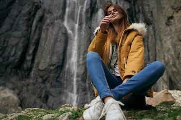 woman hiking mountain waterfall trip
