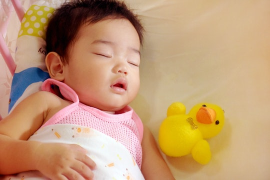 The asian baby sleeping on the bed,concept kids healthy