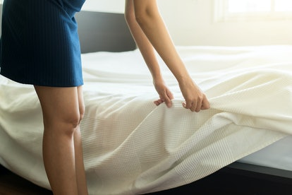 Make a bed,Woman making her bed in room after wake up