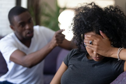 Tired frustrated african wife ignoring angry black despot husband arguing blaming upset woman of problems, jealous man shouting at sad girlfriend, family fight and controlling boyfriend, disrespect