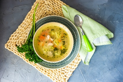 Healthy food concept with chicken soup on rustic background with copy space