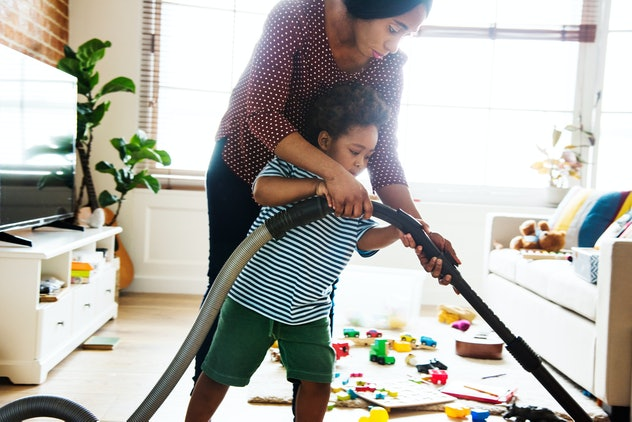 Son helping his mother clean the room