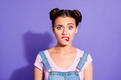 Close up photo beautiful amazing she her lady two hair buns bite lip oh no sorry guilty despair expression wear casual t-shirt jeans denim overalls clothes isolated purple violet background