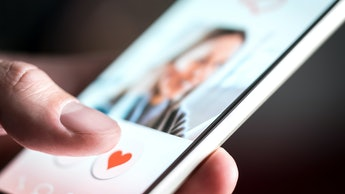 Dating app or site in mobile phone screen. Man swiping and liking profiles on relationship site or a...