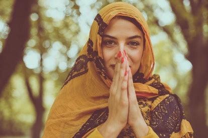 Religious woman praying . Muslim.