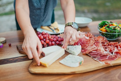 Cheese plate on a beautiful wooden table in a garden outside