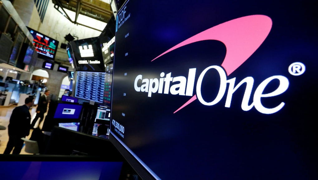 The logo for Capitol One Financial appears above a trading post on the floor of the New York Stock Exchange, . A security breach at Capital One Financial, one of the nation's largest issuers of credit cards, compromised the personal information of about 106 million people, and in some cases the hacker obtained Social Security and bank account numbers