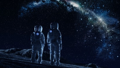 Crew of Two Astronauts in Space Suits Standing on the Moon Looking at the The Milky Way Galaxy. High...