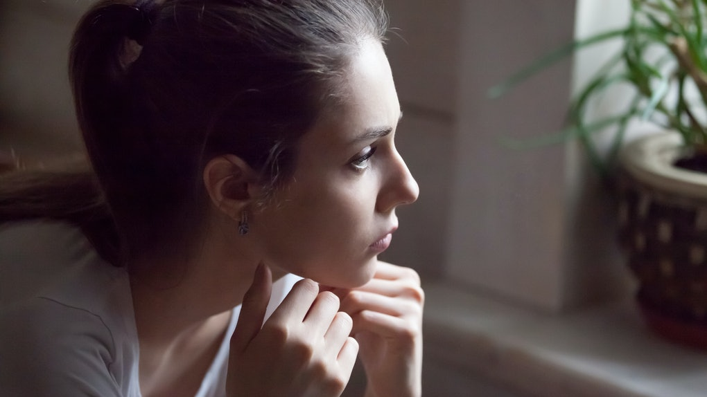 Upset young woman look far in window thinking about personal troubles, sad female feeling blue after breakup with lover or boyfriend, hurt offended girl grieve at home having relationships problems