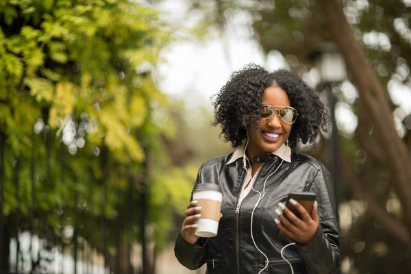 Woman texting and talking on the phone.
